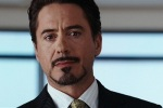 Tony Stark announces at a press conference that he is Iron Man.