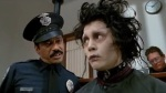 Edward Scissorhands in prison talking to a police officer, Deja Reviewer