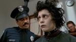 Edward Scissorhands in prison talking to a police officer, Deja Reviewer