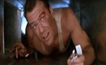 John McClane crawls through an air duct.