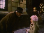 "A young caroler says ""I love you, Mr. Krueger"" after inviting him to sing with them."