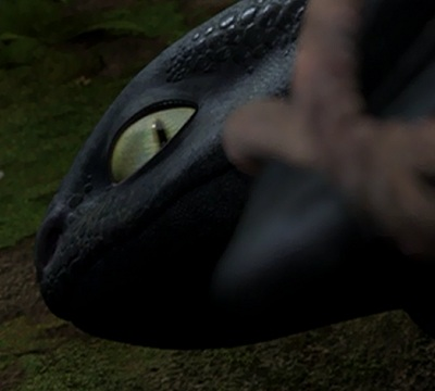 10 cool details you may have missed in how to train your dragon toothless eye is suddenly open making him look both sinister and scared ccuart Image collections