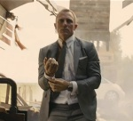 James Bond shrugs off a shoulder injury and proceeds with style.