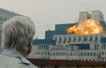 M watches helplessly as MI6 headquarters is destroyed in an explosion