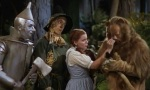 Tin Man, Scarecrow and Dorothy comfort Cowardly Lion in 1939's The Wizard of Oz.