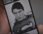 Superman cuts off the photos that would reveal him as Clark Kent.