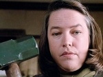 Annie Wilkes is a deranged fan who tries to knock sense into her favorite author.