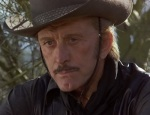 Kirk Douglas plays the titular villain, Cactus Jack Slade.