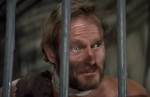 Taylor finds himself caged like an animal on a planet where human are considered backwards creatures.