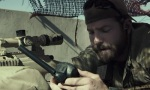 Kyle calls his wife during his deployment when he's supposed to be concentrating on a mission.