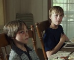 The scene where Kyle's father tells him that there are three types of people - sheep, wolves, and sheepdogs - is a pivotal moment that informs Kyle's actions throughout the film.