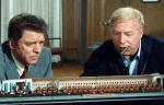 George Kennedy helps Burt Lancaster solve a serious problem in the first Airport film.