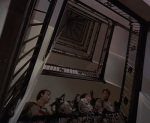 The Ghostbusters slowly make their way up two dozen flights of stairs.
