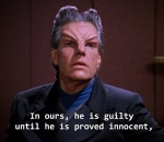 The investigator demands Riker prove his innocence rather than presuming his innocence until proven guilty.