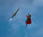 Superman kicks a missile. Awesome.