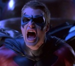 Robin is equal parts angry and whiny in Batman & Robin.