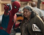 Spider-Man gives an old lady directions in a wonderfully small-scale montage of crimefighting.