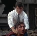 Clark Kent chokes the evil Superman.