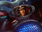 Commissioner Gordon delivers exposition on a viewscreen in the Batmobile.