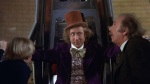 Willy Wonka lifts up Charlie and Grandpa Joe in his Great Glass Wonkavator.